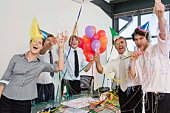 Businesspeople with party supplies