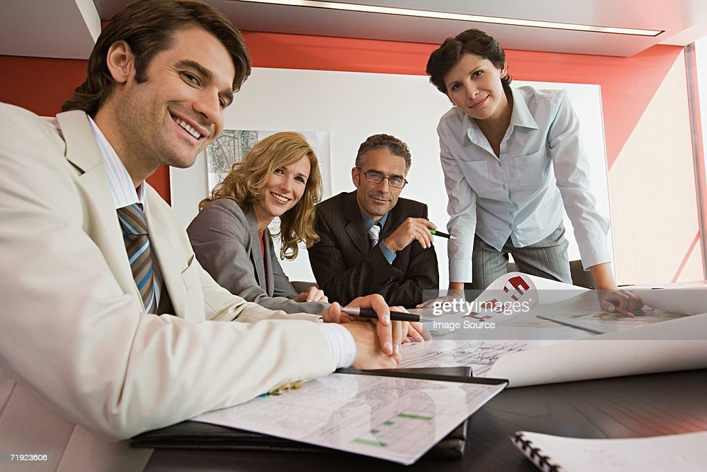 Businesspeople with plans : Stock Photo