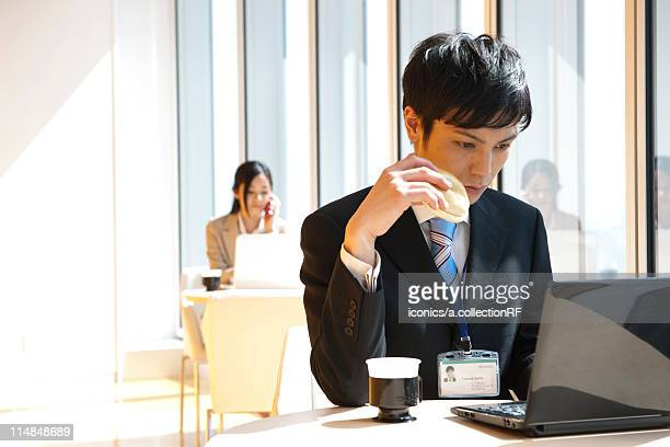 Businesspeople working at a cafe, Tokyo Prefecture, Honshu, Japan