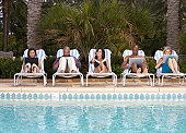 Businesspeople working at poolside