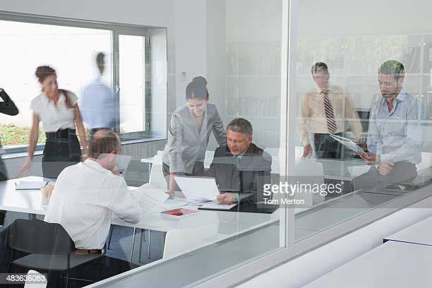 Businesspeople working in busy conference room