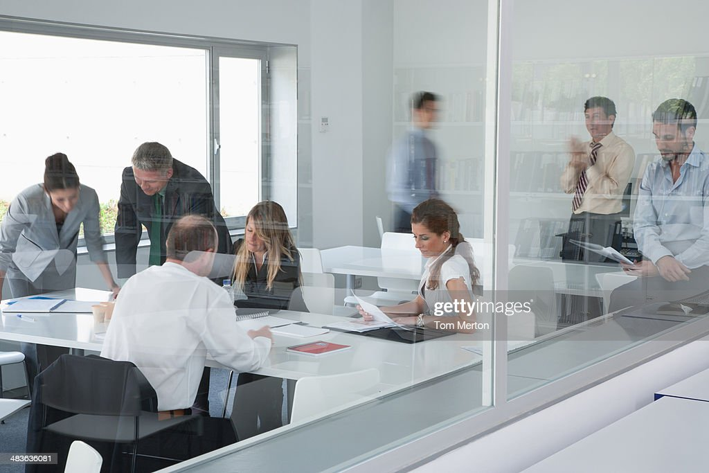 Businesspeople working in corporate training facility : Stock Photo