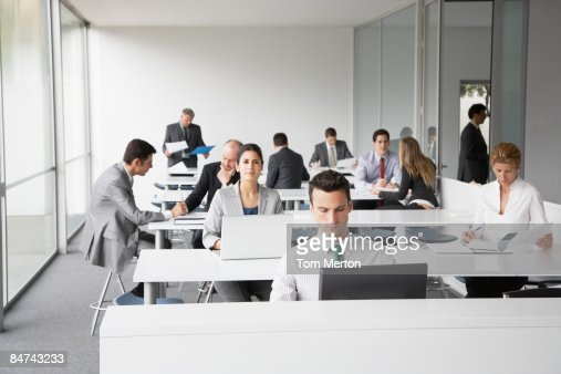 Businesspeople working in corporate training facility : Foto de stock