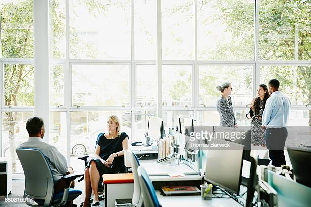 Businesspeople working in high tech office