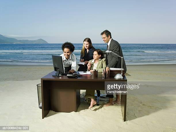 Businesspeople working on beach