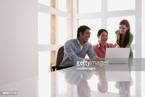 Businesspeople working on laptop : Stock Photo