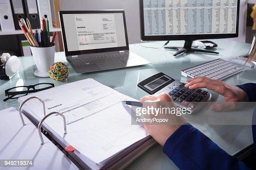 Businessperson Calculating Invoice : Stock Photo