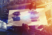 Businessperson in office work together with network effect. concept of partnership and teamwork. double exposure
