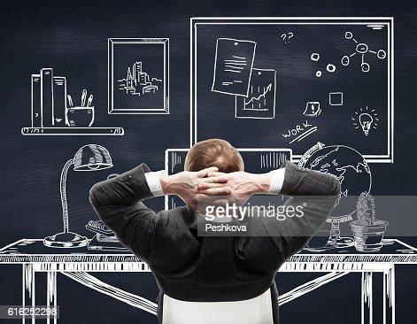 Businessperson relaxing in drawn office : Foto de stock