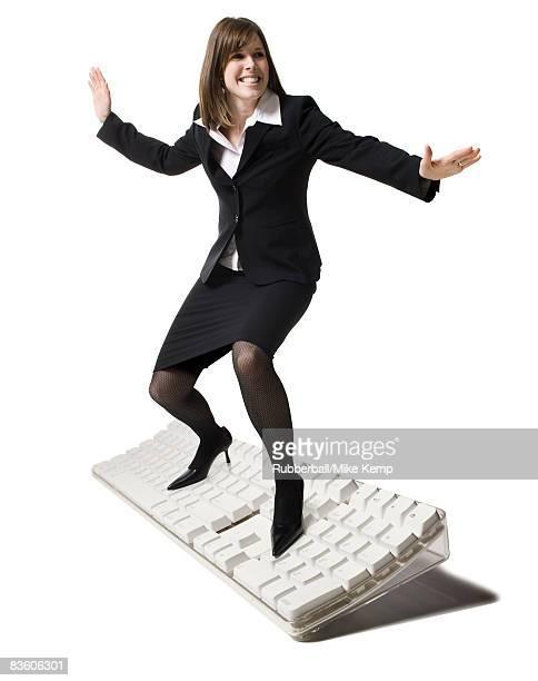 businessperson surfing on a keyboard