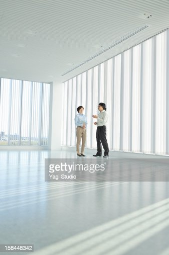 Businessperson talking in hall of office : Stock Photo