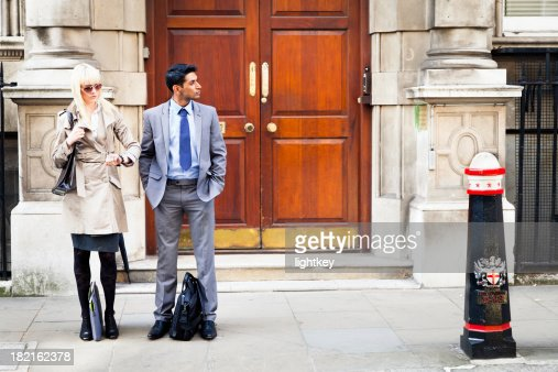 Businesspersons waiting for a taxi