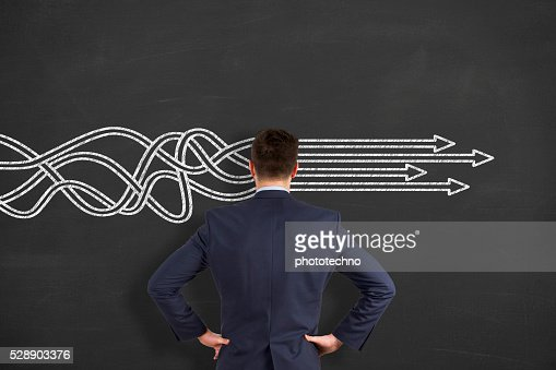 BusinessThinking about structuring business process and solutions : Stock Photo