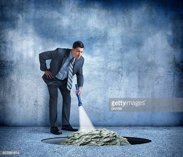 BusinessUse Flashlight To Find Pile Of Money In Hole
