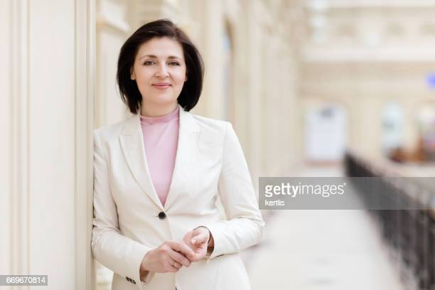 Businesswoman 50 years old in a white jacket