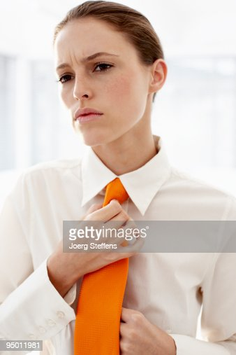 Businesswoman adjusting tie : Stock Photo