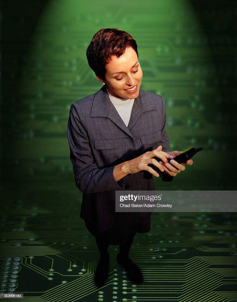 Businesswoman Against Circuit Board