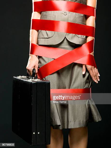 businesswoman all wrapped up in red ribbon