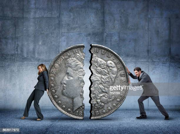Businesswoman And Businessman Attempt To Push Together A Silver Dollar Broken In Half