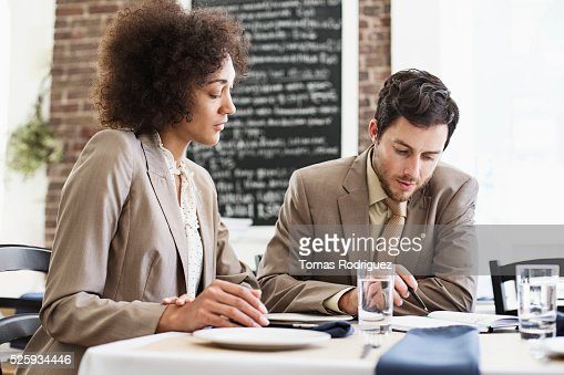 Businesswoman and businessman having meeting in restaurant : Stock Photo