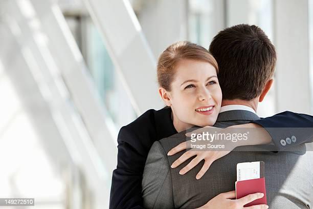 Businesswoman and businessman hugging