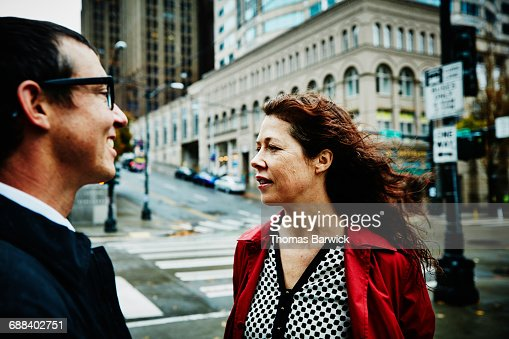 Businesswoman and businessman on city street