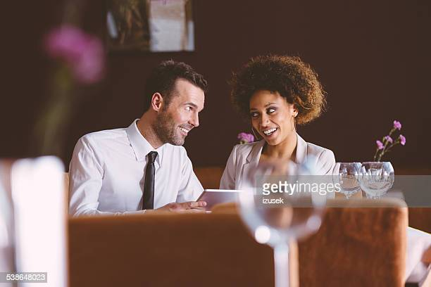 Businesswoman and businessman on lunch