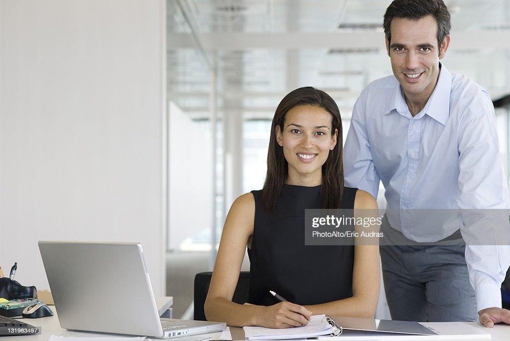 Businesswoman and businessman, portrait