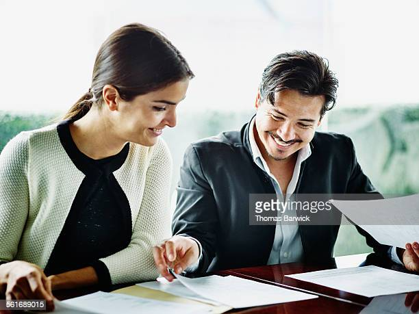 Businesswoman and businessman reviewing documents