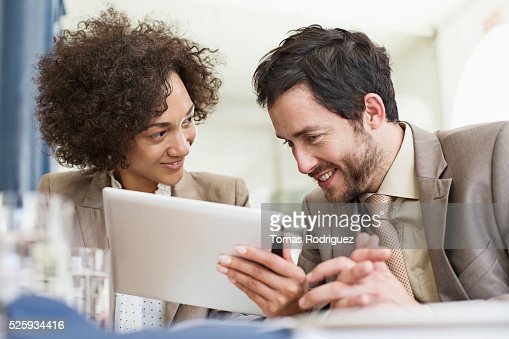 Businesswoman and businessman using tablet PC : ストックフォト