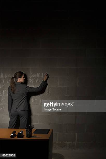 Businesswoman and chalk marks on wall