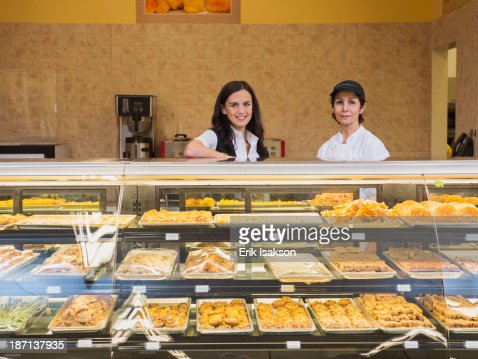 Businesswoman and chef at restaurant counter