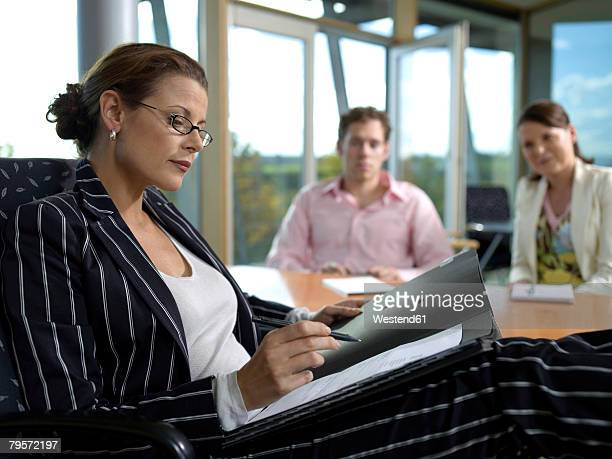 Businesswoman and co-workers in office
