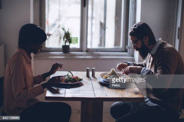 Businesswoman and man having a business conversation at restaurant