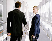 Businesswoman and man with luggage