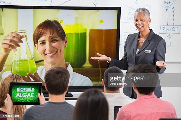 Businesswoman and scientist giving video conference