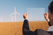 Businesswoman and wind turbine.