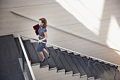 Businesswoman ascending office staircase