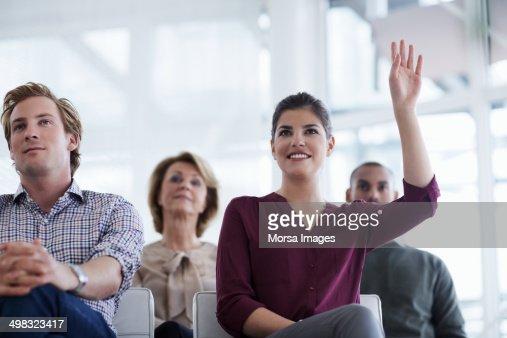 Businesswoman asking question