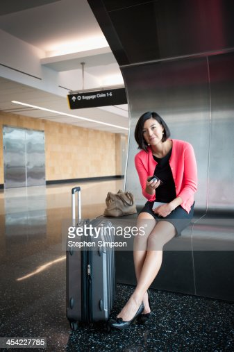 businesswoman at  airport between flights