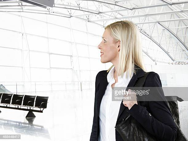 Businesswoman at airport, looking away
