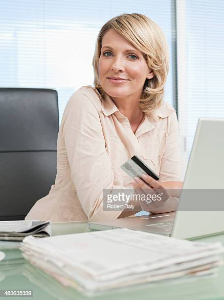 Businesswoman at computer with credit card
