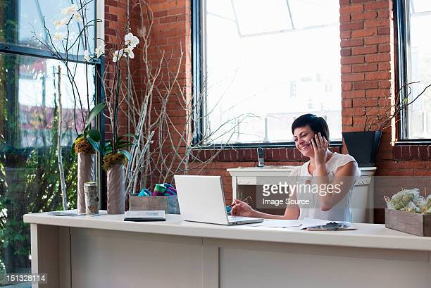 Businesswoman at desk on the phone