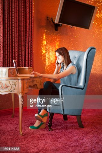 Businesswoman at desk : Stock Photo