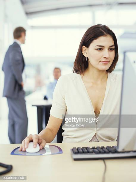 Businesswoman at desk using PC