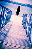 Businesswoman at end of dock