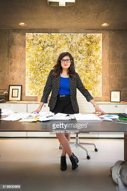 businesswoman at her desk in architectural office