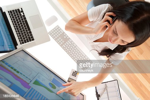 Businesswoman at her desk on the phone