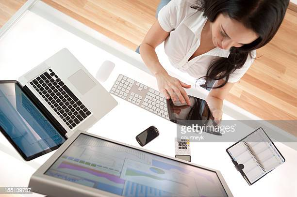 Businesswoman at her desk using a digital tablet