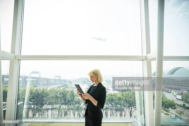 Businesswoman At The Airport, Airplane On Background